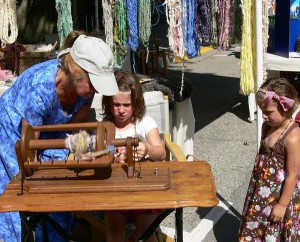children learning to spin, teaching fibre arts