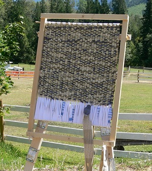 home built rug-making loom on easel